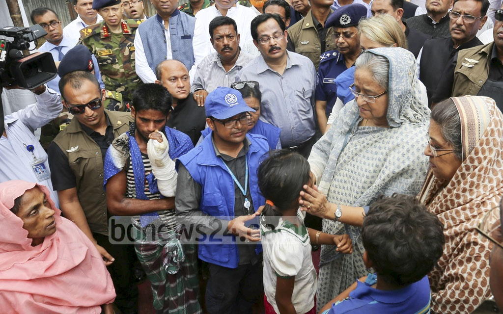 File Photo: Sheikh Hasina speaks to Rohingyas during a visit to refugee camps in Cox's Bazar on Sept 12, 2017.