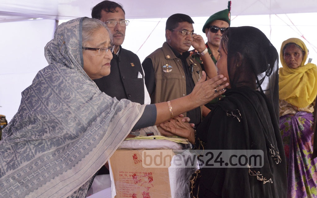 Prime Minister Sheikh Hasina distributes aid among Rohingyas at the Kutupalong refugee camp in Cox's Bazar's Ukhia on Tuesday. Photo: habibur rahman