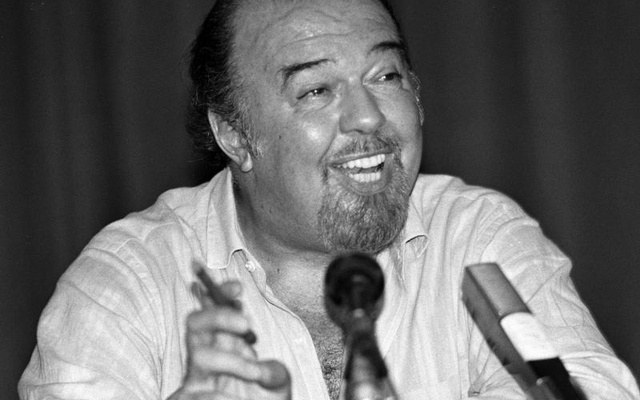 FILE PHOTO: British national theatre director Sir Peter Hall talks to journalists during a press conference in Athens, Greece, August 8, 1988. Reuters