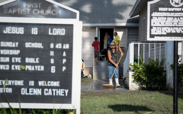 Residents clean up after Hurricane Irma heavily damaged the First Baptist Church in Everglades City, Florida, U.S., September 11, 2017. Reuters