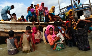 Rohingya refugees get off a boat after crossing the Bangladesh-Myanmar border through the Bay of Bengal, in Shah Porir Dwip, Bangladesh Sept 11, 2017. Reuters