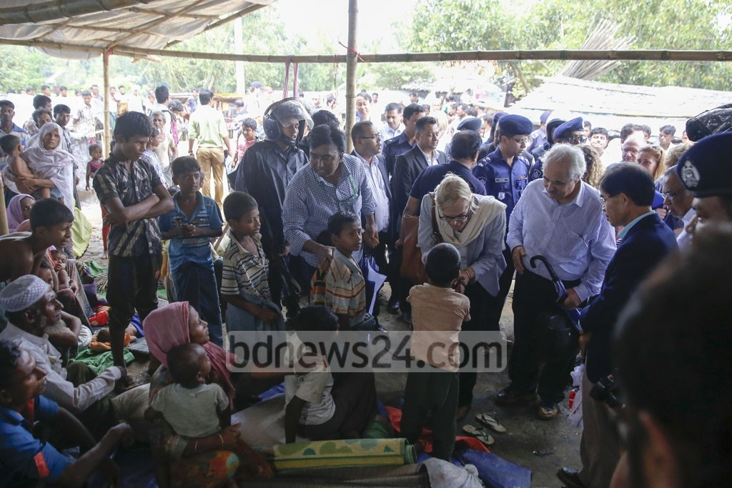 Dhaka-based foreign diplomats speak to Rohingyas during a visit to a refugee camp at Kutupalong, Cox's Bazar on Wednesday.