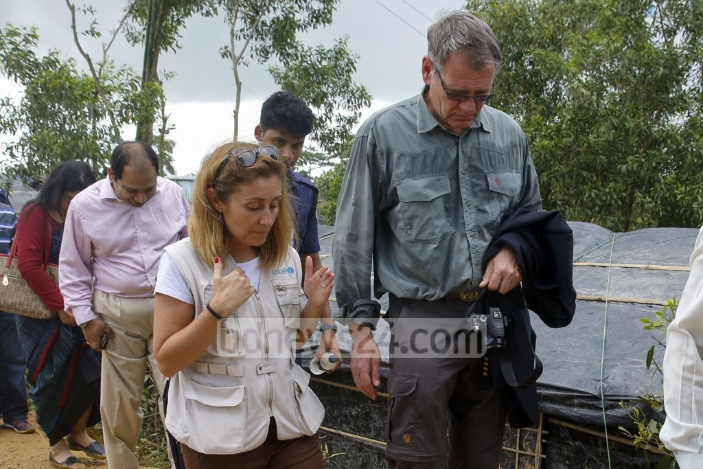 German Ambassador Thomas Prinz and other Dhaka-based diplomats walk through a muddy refugee camp at Kutupalong in Cox's Bazar on Wednesday.