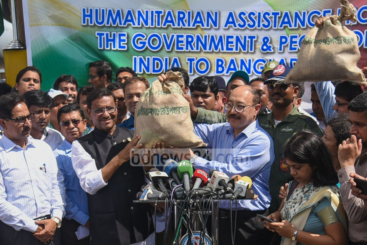 Indian High Commissioner Harsh Vardhan Shringla formally hands a relief consignment for Rohingyas to Awami League General Secretary Obaidul Quader at Chittagong airport on Thursday. Photo: suman babu
