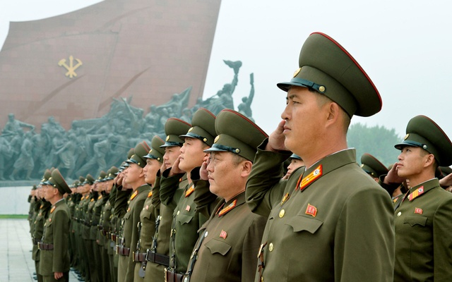 North Korean soldiers salute at Mansudae hill in Pyongyang, North Korea, in this photo taken by Kyodo, Sept 9, 2017 on the 69th founding anniversary of the country. Kyodo/via Reuters