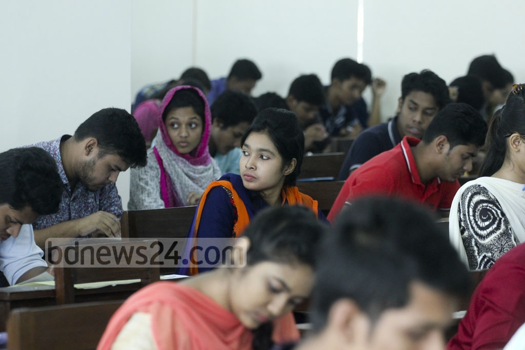 Candidates take Dhaka University's 'Ga' unit admission test at a centre on Friday. A total of 29,311 students registered for the test this year. Photo: abdul mannan