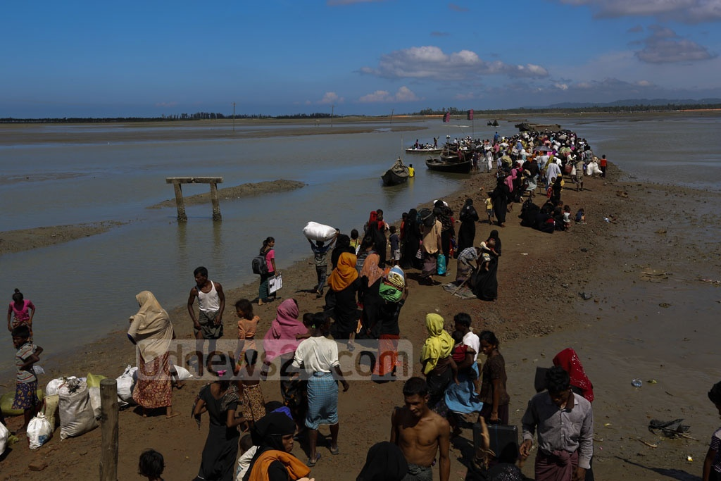 Rohingyas wait for boats at Shah Porir Dwip to go to the mainland in Cox's Bazar's Teknaf. Photo taken on Saturday. Photo: mostafigur rahman