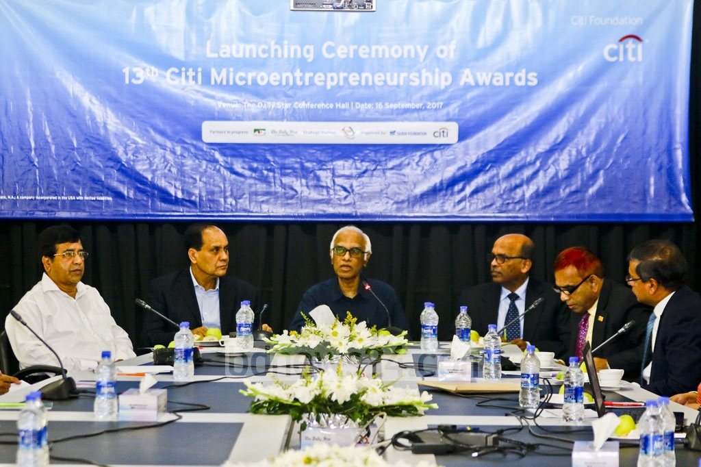 Economist Wahiduddin Mahmud addresses the Citi Foundation's media briefing on Saturday over the 13th Citi Microentrepreneurship Awards at The Daily Star Centre.