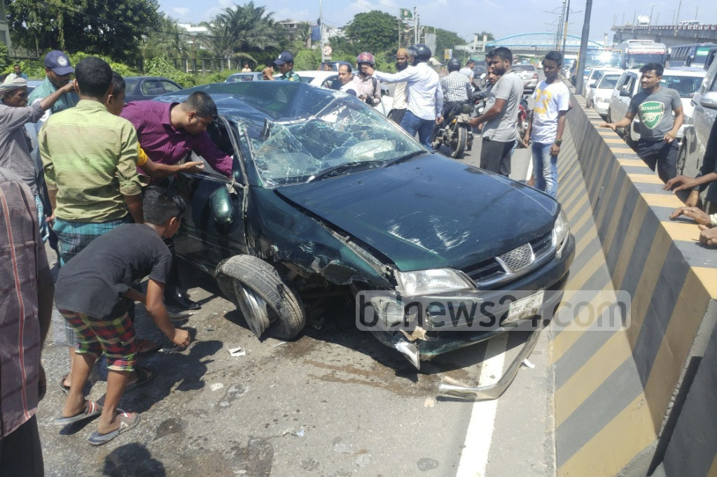 An accident leaves a car damaged on Dhaka's Kuril Biswa Road. Photo: abdul mannan