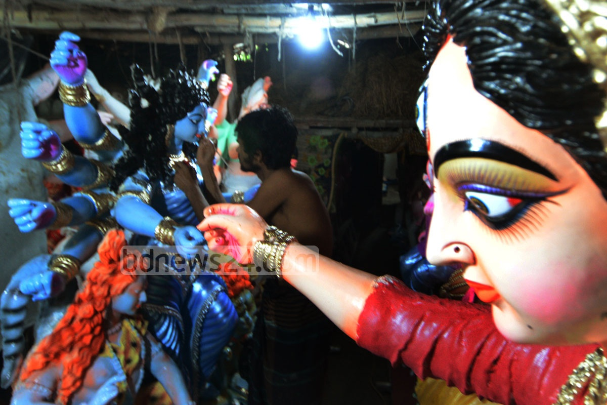 A last-minute touch-up to the idol Durga at CRB area in Chittagong as the biggest Hindu festival Durga Puja is just a few days away. photo: suman babu