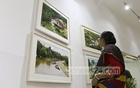 A visitor appreciates a photo in the solo exhibition on the life and culture of small ethnic groups in the Chittagong Hill Tracts by photographer MA Taher at the National Museum ​on Monday. photo: asif mahmud ovi​