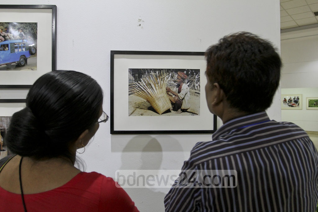 ​​​Visitors look around the ​solo photo exhibition on the life and work of small ethnic groups in the Chittagong Hill Tracts by photographer MA Taher at the National Museum ​on Monday. photo: asif mahmud ovi​