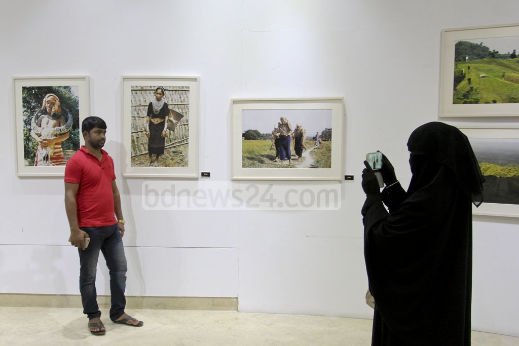 ​​By taking their own picture, some visitors tried to make their presence memorable at the ​solo photo exhibition on the life and culture of small ethnic groups in the Chittagong Hill Tracts by photographer MA Taher at the National Museum ​on Monday. photo: asif mahmud ovi​​