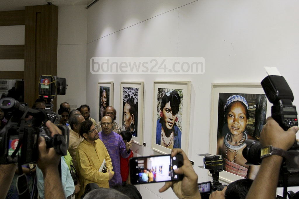 Cultural Affairs Minister Asaduzzaman Noor looks around the​​ ​solo photo exhibition on the life and culture of small ethnic groups in the Chittagong Hill Tracts by photographer MA Taher at the National Museum​ on Monday. photo: asif mahmud ovi​