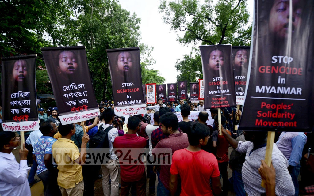 Ganasanghati Andolan activists hold placards against the ethnic cleansing of Myanmar's Rohingyas during a protest march to the UN offices in Dhaka's Agargaon on Tuesday.