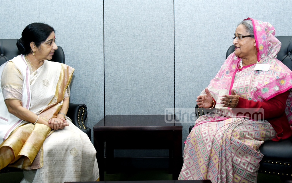Prime Minister Sheikh Hasina and Indian Foreign Minister Sushma Swaraj greet each other at the United Nations headquarters in New York on Monday. Photo: Saiful Islam Kallol