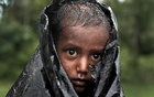 A Rohingya refugee boy waits for aid in Cox's Bazar, Bangladesh, September 20, 2017. Reuters