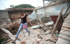 Peregrina, 26, an indigenous Zapotec transgender woman also know as Muxe, walks on the debris of her house destroyed after an earthquake that struck on the southern coast of Mexico late on Thursday, in Juchitan, Mexico, September 10, 2017. Picture taken, September 10, 2017. REUTERS