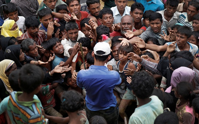 Rohingya refugees struggle to get aid in a camp in Cox's Bazar on Wednesday.