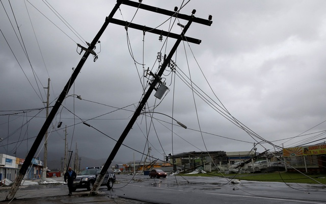 A police officer walks next to damaged electrical installations after the area was hit by Hurricane Maria en Guayama, Puerto Rico Sept 20, 2017. Reuters