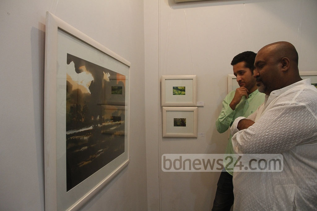 Visitor look at works of Shahanoor Mamun at the artist's solo exhibition 'Stories from Nature' at Galleri Kaya in the capital's Uttara on Friday. Photo: tanvir ahammed