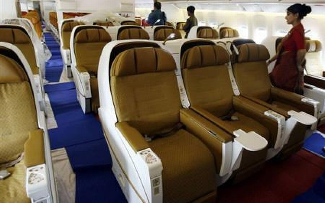 People walk inside the business class section of Air India's Boeing 777-200 LR aircraft at the Mumbai airport July 30, 2007. Reuters