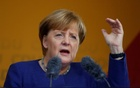 German Chancellor Angela Merkel, a top candidate of the Christian Democratic Union Party (CDU) for the upcoming general elections, gestures as she speaks during an election rally in Fritzlar, Germany September 21, 2017. Reuters