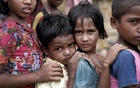 Rohingya refugee children queue for aid in Cox's Bazar, Bangladesh, September 21, 2017. Reuters