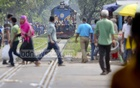 Pedestrians crossing the railway tracks at Mohakhali in the capital on Saturday when the approaching train is just seconds away from the level crossing. Photo: asaduzzaman pramanik