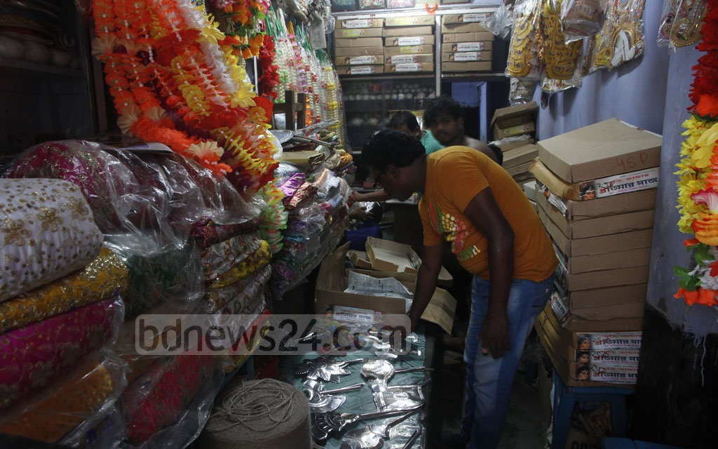 New decorative items for Puja Mandaps are on display at a shop in Shankhari Bazar in Dhaka on Saturday ahead of Durga Puja. Photo: tanvir ahammed