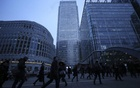 Workers walk to work during the morning rush hour in the financial district of Canary Wharf in London, Britain, January 26, 2017. Reuters