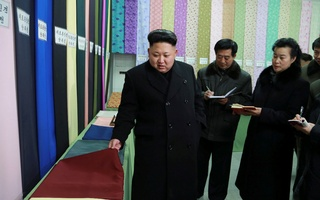 North Korean leader Kim Jong Un gives field guidance at the Kim Jong Suk Pyongyang Textile Mill in this undated photo released by Korean Central News Agency in Pyongyang in 2014. REUTERS