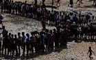 Rohingya refugees queue for aid in Cox's Bazar, Bangladesh, Sept 21, 2017. Reuters