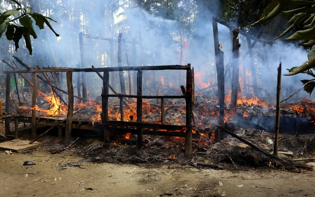 File Photo: A house is seen on fire in Gawduthar village, Maungdaw township, in the north of Rakhine state, Myanmar September 7, 2017. Reuters