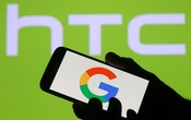 The Google logo is seen on a smartphone in front of a displayed HTC logo in this illustration taken Sep 21, 2017. Reuters