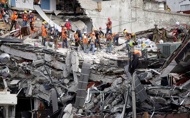 Members of rescue teams continue to search for people under the rubble of a collapsed building, after an earthquake, in Mexico City, Mexico Sept 23, 2017. Reuters
