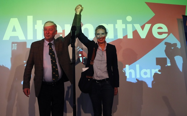 Alice Weidel and Alexander Gauland, top candidates of the anti-immigration party Alternative fuer Deutschland (AfD) react after first exit polls in the German general election (Bundestagswahl) in Berlin, Germany, Sept 24, 2017. Reuters