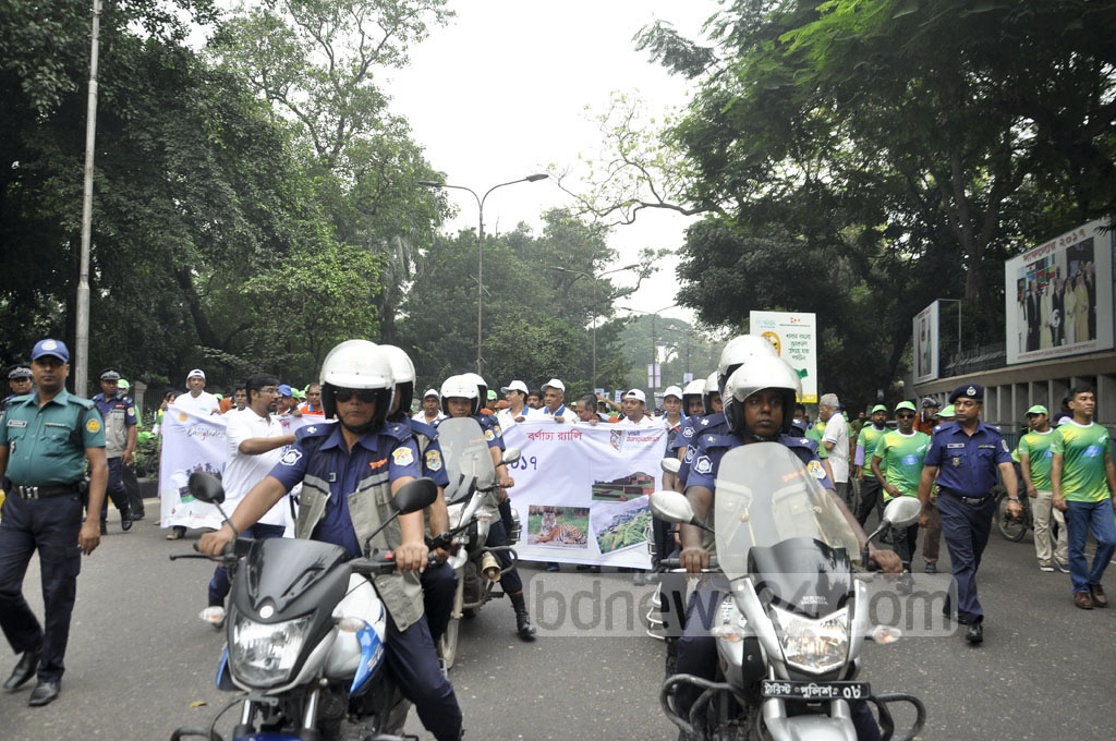Tourist police personnel hold a procession in Dhaka to honour World Tourism Day on Wednesday.