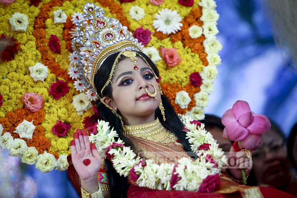 Kumari Puja being held on the Mahashtami of Durga Puja by worshiping this child as a juvenile deity at the Ramkrishna Mission in Dhaka. Photo: asif mahmud ove