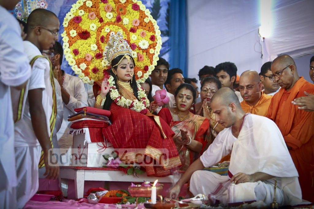 Kumari Puja being held on the Mahashtami of Durga Puja by worshiping living icon of a child Durga at the Ramkrishna Mission in Dhaka. Photo: asif mahmud ove