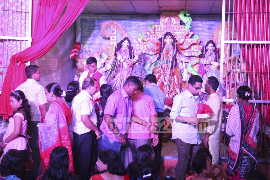 Hindu devotees worship Goddess Durga at a Puja Mandap set up by Mirpur-2 Sarbojonin Puja Committee in Dhaka on the Maha Nabami on Friday.