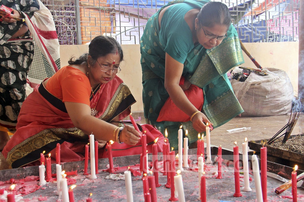 Worshippers seek blessings from Goddess Durga as priests perform Nabami rituals before her idol at Dhaka's Dhakeshwari Temple on Friday.