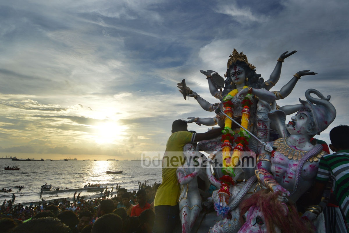 Adieu Durga! Hindu devotees immerse an idol of the goddess by the end of the Durga Puja at Chittagong's Patenga Beach on Saturday. Photo: suman babu