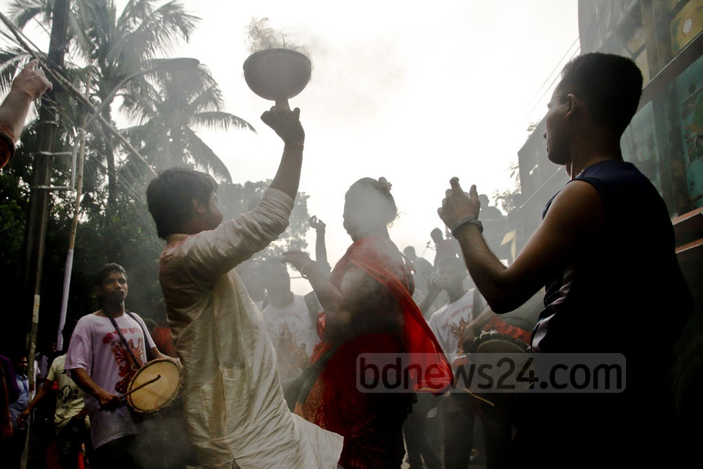 Hindu devotees dance in celebration of their largest festival Durga Puja at Palashi in Dhaka before Bisarjan​ or the​ immersion of the idol of the goddess. Photo: tanvir ahammed
