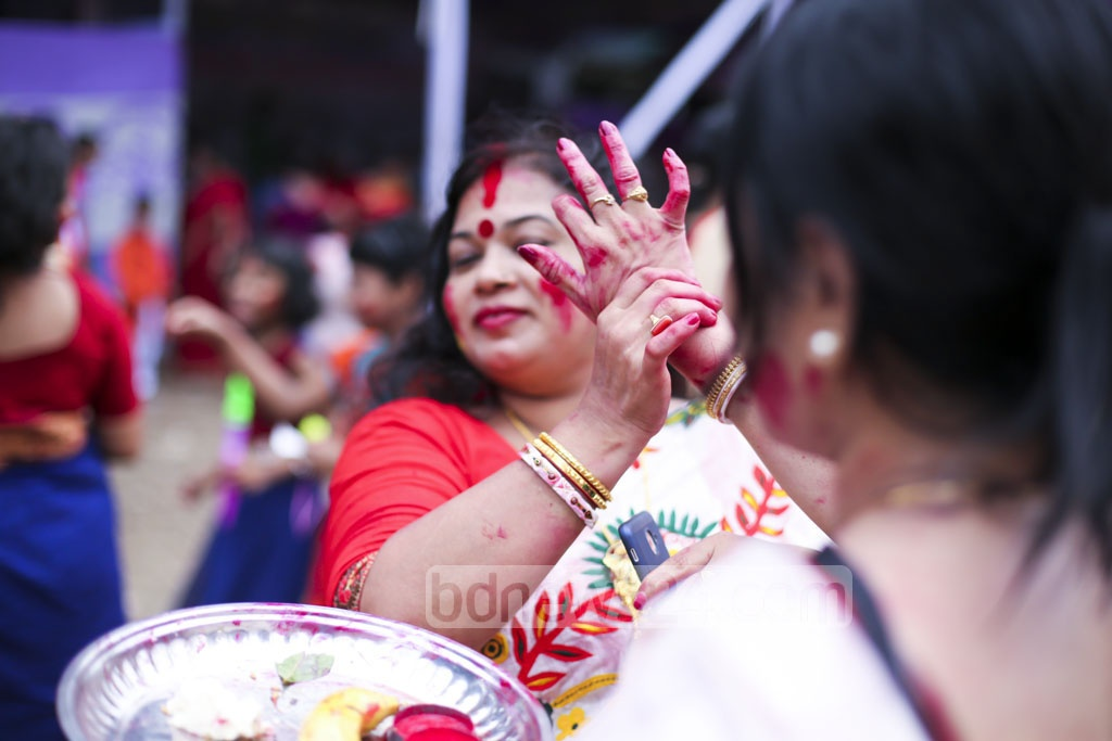 Hindu women celebrate the last day of Durga Puja with sindur or vermillion at Dhaka's Kalabagan pavilion on Saturday. Photo: abdul mannan