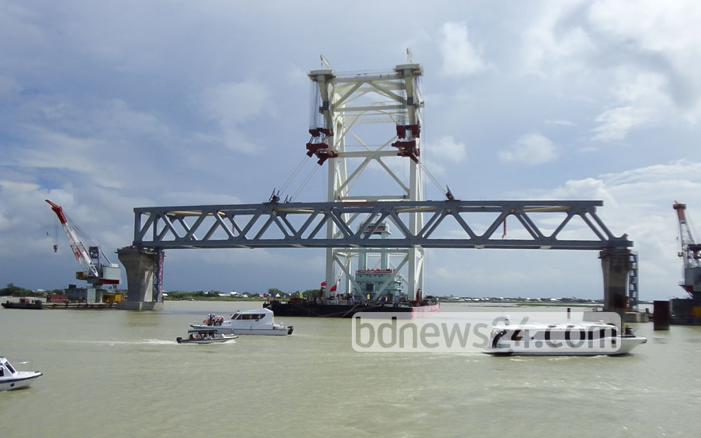 The first beam between two pillars of the Padma Bridge, one of the largest infrastructure projects in Bangladesh, has been installed on Saturday. The 6.15-kilometre bridge will have 42 pillars, including two on the banks.