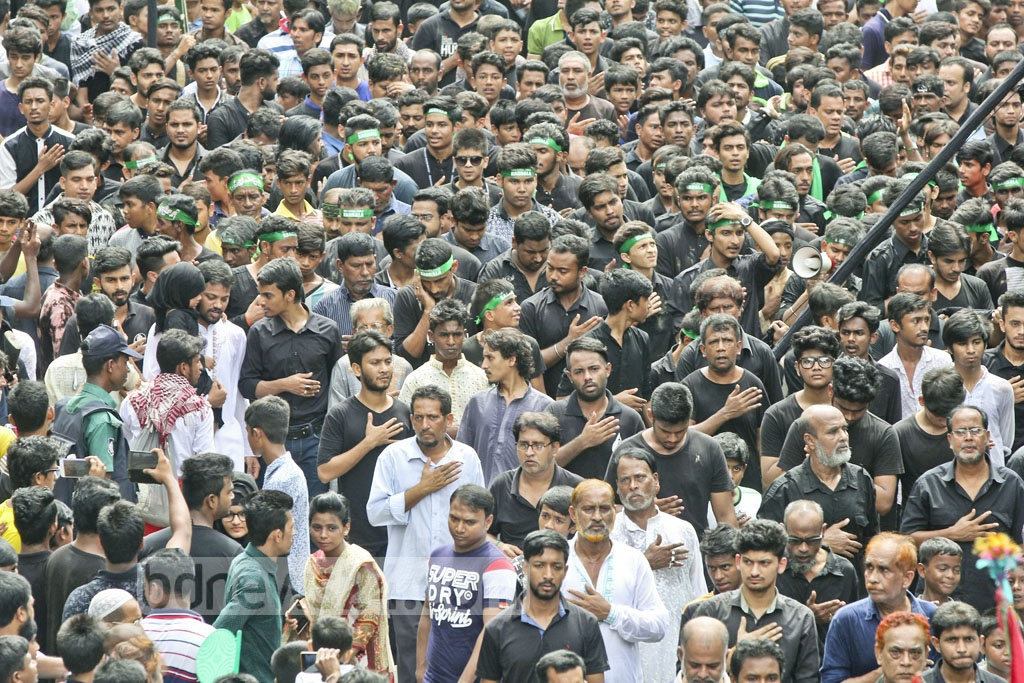 Shia Muslim men mourn during the Ashura procession on Sunday, marking the martyrdom of Imam Hussain ibn Ali, grandson of Prophet Muhammad (pbuh), in the battle of Karbala. Photo: asif mahmud ove