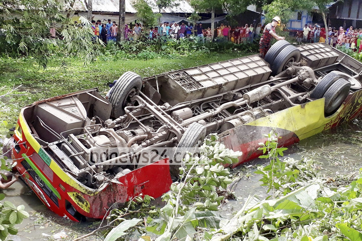 A bus overturns as it falls into a ditch at Nuritola of Comilla's Chandina on Dhaka-Chittagong Highway, killing seven passengers including children on Sunday.