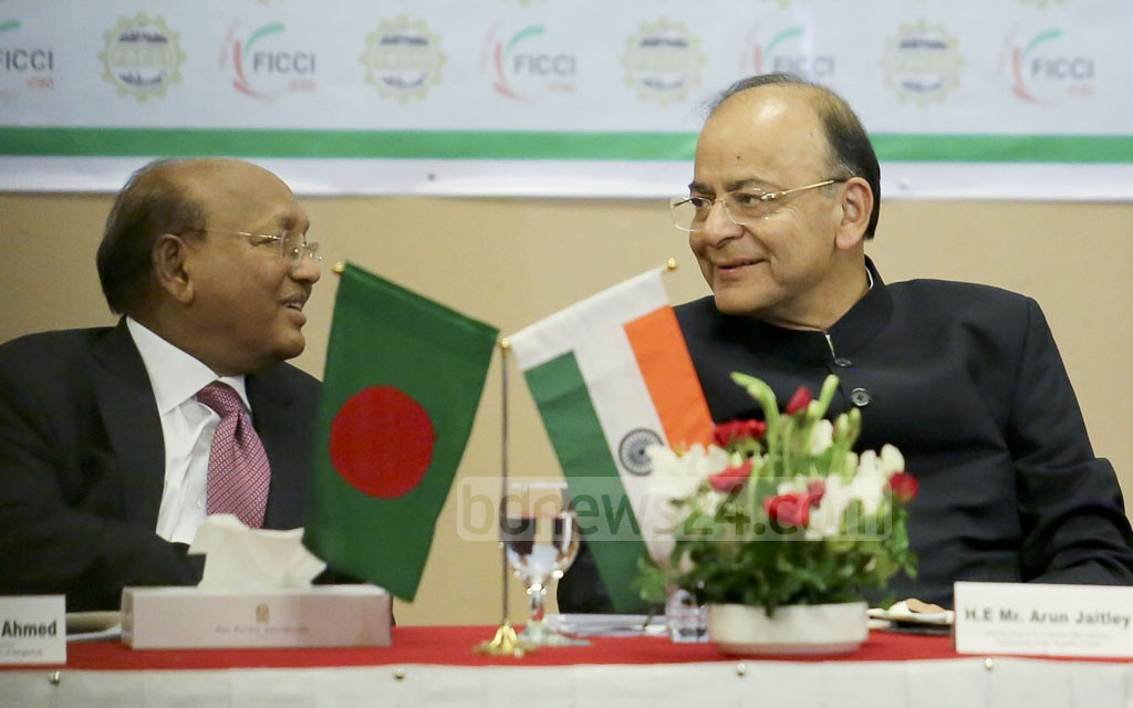 Indian Foreign Minister Arun Jaitley interacts with Bangladesh Commerce Minister Tofail Ahmed during a discussion on India-Bangladesh trade relations at Dhaka's Pan Pacific Sonargaon Hotel on Tuesday. Photo: md asaduzzaman pramanik