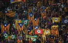 Fans raise pro-independence flags and banners during a Spanish La Liga match between Girona and Barcelona at Montilivi stadium in Girona, Spain, September 23, 2017. Reuters